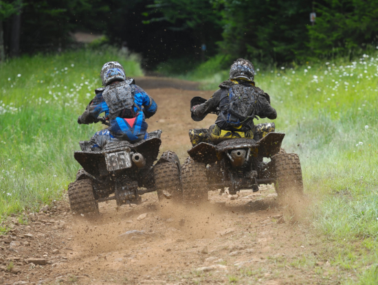 Photo of two atvs racing cross country
